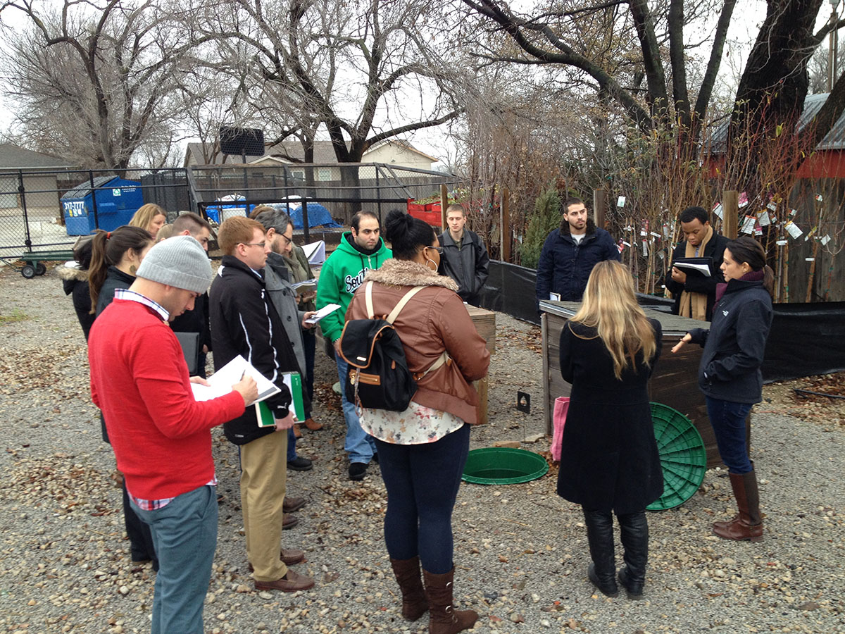 Carla Grogg, operations manager of Grogg's Green Barn, describes how the organic nursery collects rainwater to use for irrigating plants to an OSU-Tulsa sustainability course during the 2015 winter intersession.