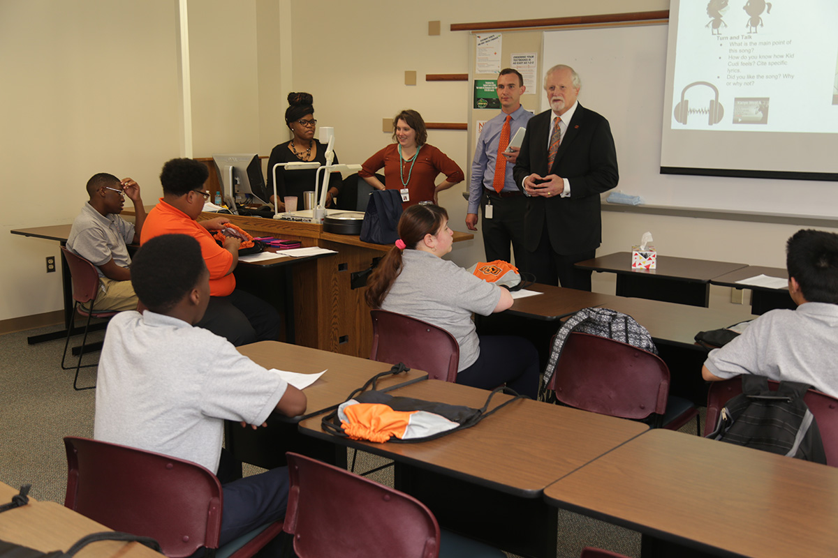 OSU-Tulsa President Howard Barnett, center, welcomes KIPP Tulsa University Prep High School students to campus. Standing from left are Jamia Newson, assistant school leader, Sarah Seekins, composition teacher and Chris Mahnken, school leader.
