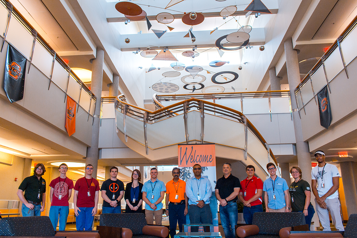 REU scholars Ethan Reynolds, from left, Tanner Burns, Matthew Luebbe, Jeremy Schumacher, Lynsey Baxter, Matthew Dieterle, Dr. Ranji Vaidyanathan, Dr. Pankaj Sarin, Dr. Jim Smay, Andrew Granger, Jordan Sosa, Leah McMillan and Geremiah Charles