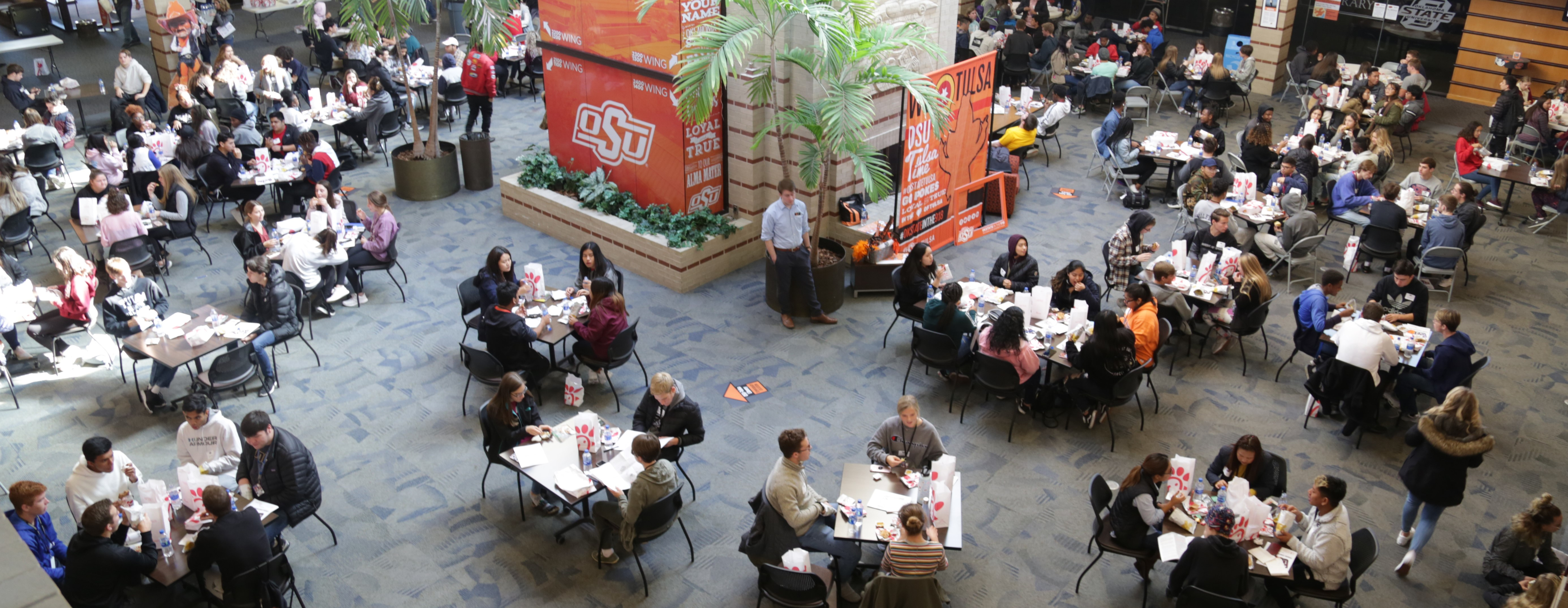 Photo of high school students eating lunch during pre-collegiate conference at OSU-Tulsa