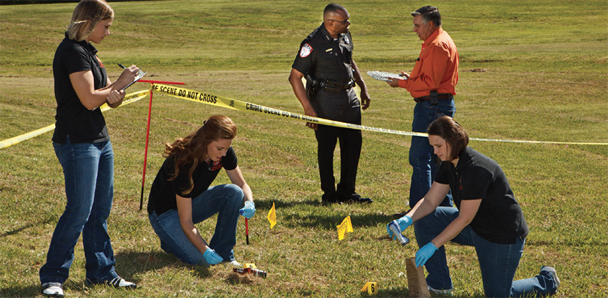 Image of students participating in a mock crime scene exercise