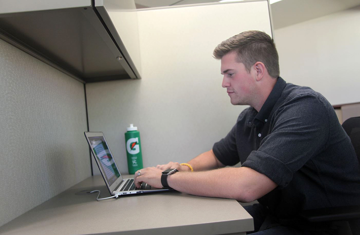 Jens Jespersen, graduate assistant in the Human Development and Family Science program, takes advantage of the new graduate assistant workspace to study.