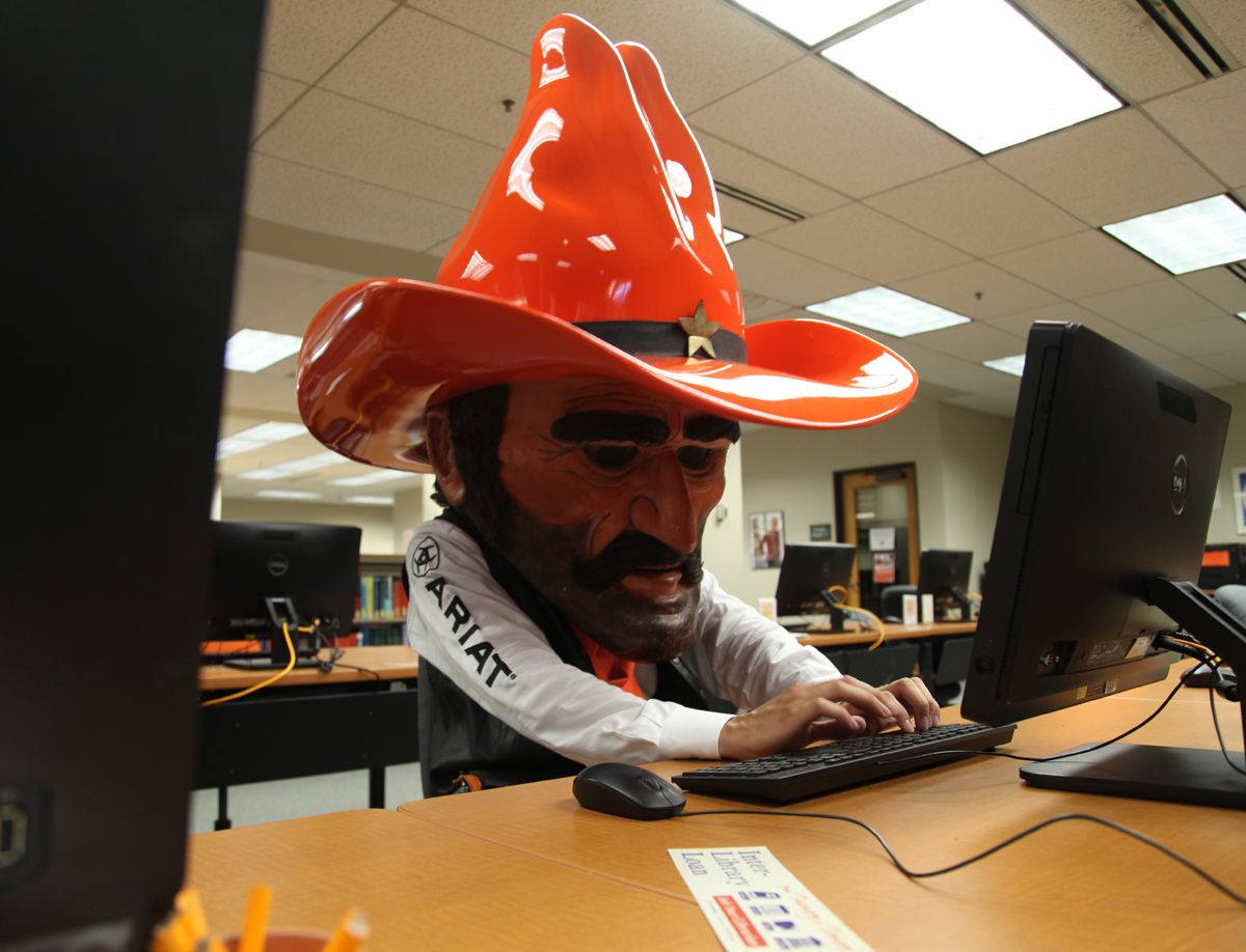 Pistol Pete studies for his final in the OSU-Tulsa Library.