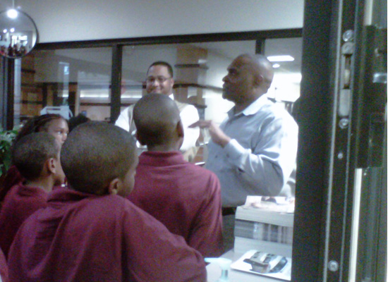 Chief Murdock gives visiting students a tour of the OSU-Tulsa police office.