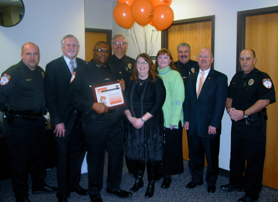 The OSU-Tulsa Police Department receiving an OSU Pride Works award in recognition for the Department's certification through the Oklahoma Association of Chiefs of Police.