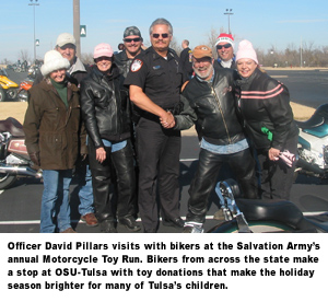 Officer David Pillars visits with bikers at the Salvation Army's annual Motorcycle Toy Run