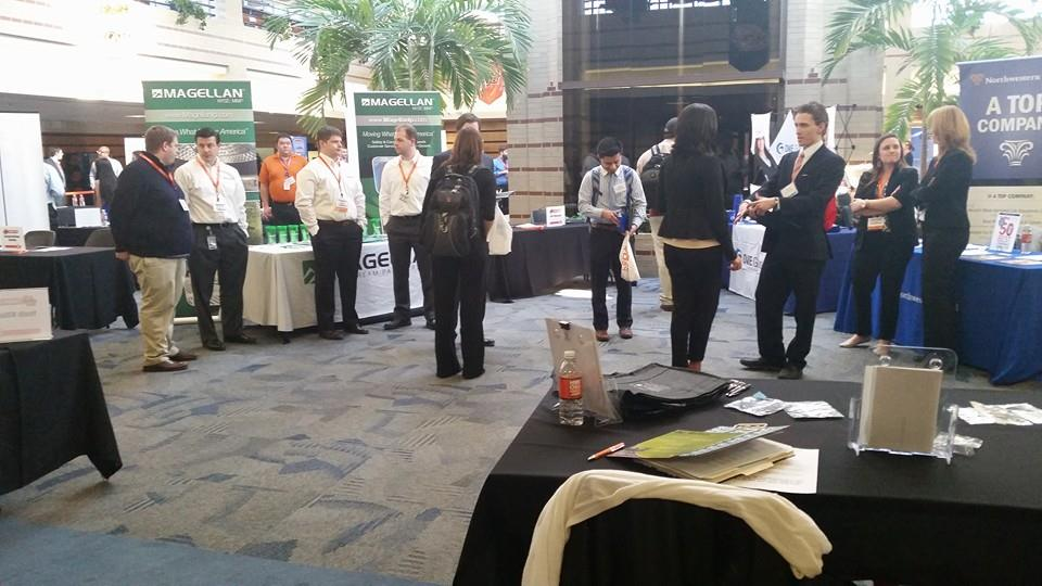 Employers speak with student job seekers at the OSU-Tulsa Career Fair.
