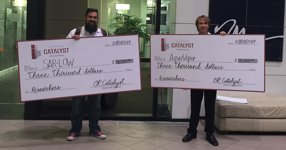 Dan Lowry (left) and Andrew Williamson with their awards from the Oklahoma Catalyst Researchers program.