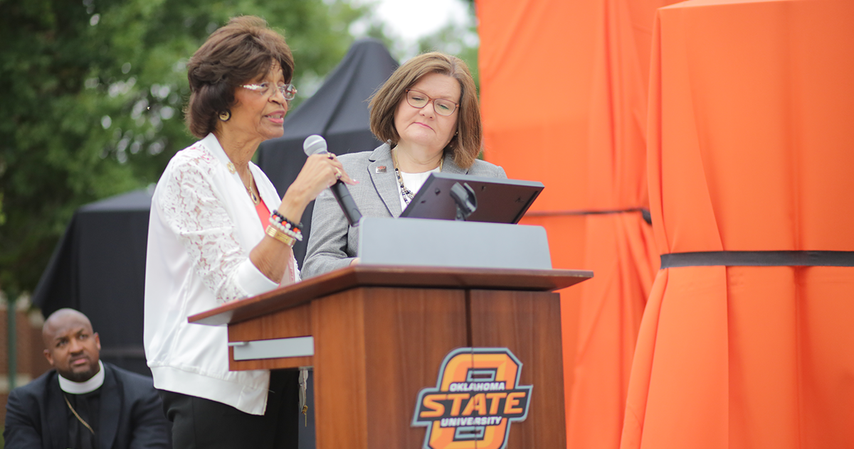 Dr. La Verne Ford Wimberly presents OSU-Tulsa President Pamela Fry with a proclamation entrusting the Ellis Walker Woods Memorial to OSU-Tulsa.