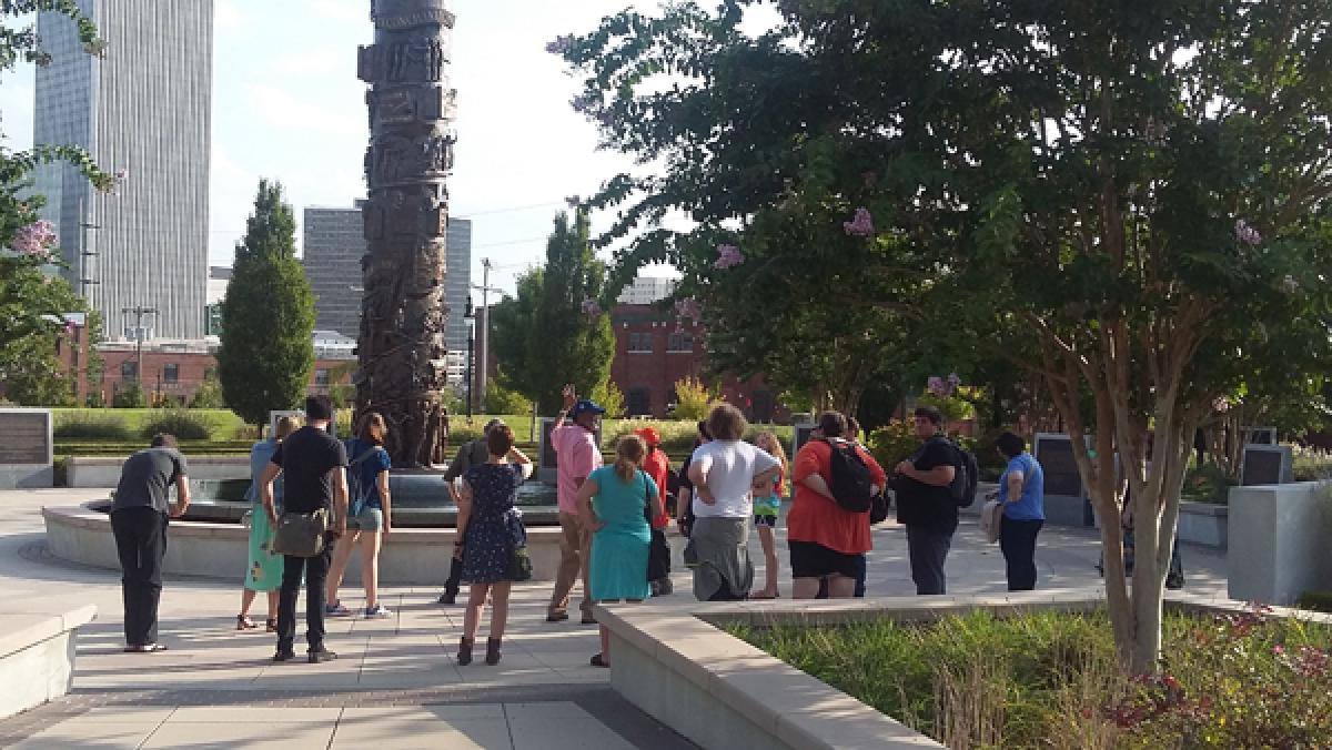 Julius Pegues, director of the John Hope Franklin Center, leads a tour of the John Hope Franklin Reconciliation Park for a class taught by Dr. David Gray, visiting professor of American studies.