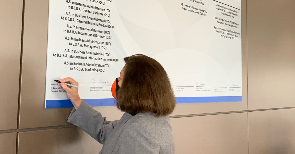 OSU-Tulsa President Dr. Pamela Fry marks National Transfer Student Week by signing off on 10 renewed transfer pathways with Tulsa Community College.