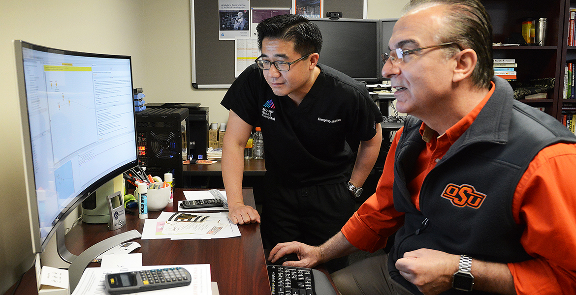 OSU data science researcher Dr. Dursun Delen (right) collaborated with Icahn School of Medicine biomedical researcher and physician Dr. Paul Peng on using machine learning algorithms to improve care for ER patients.