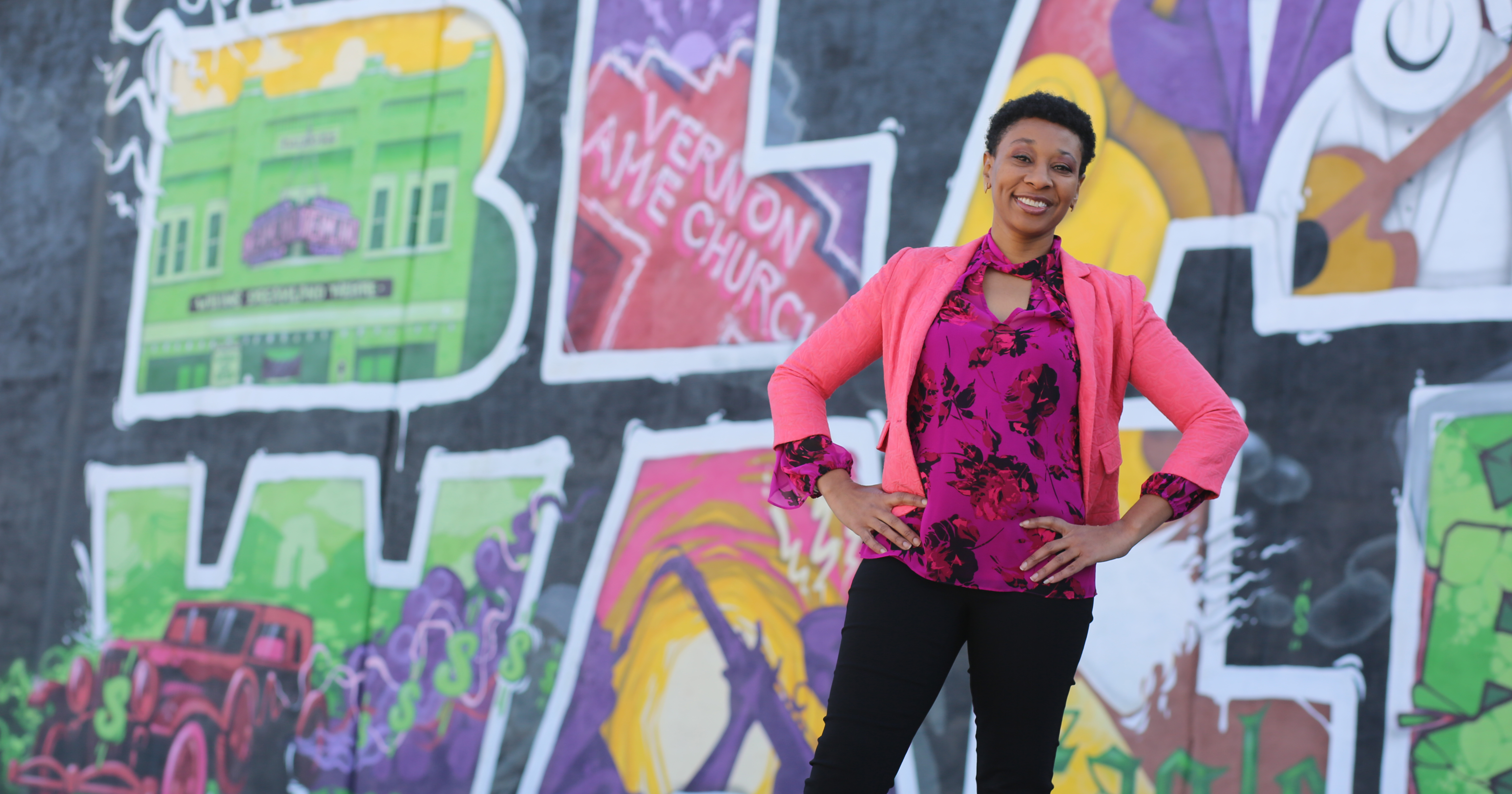 Statewide activist and public speaker D'Marria Monday poses for a photo in Tulsa's historic Greenwood District.