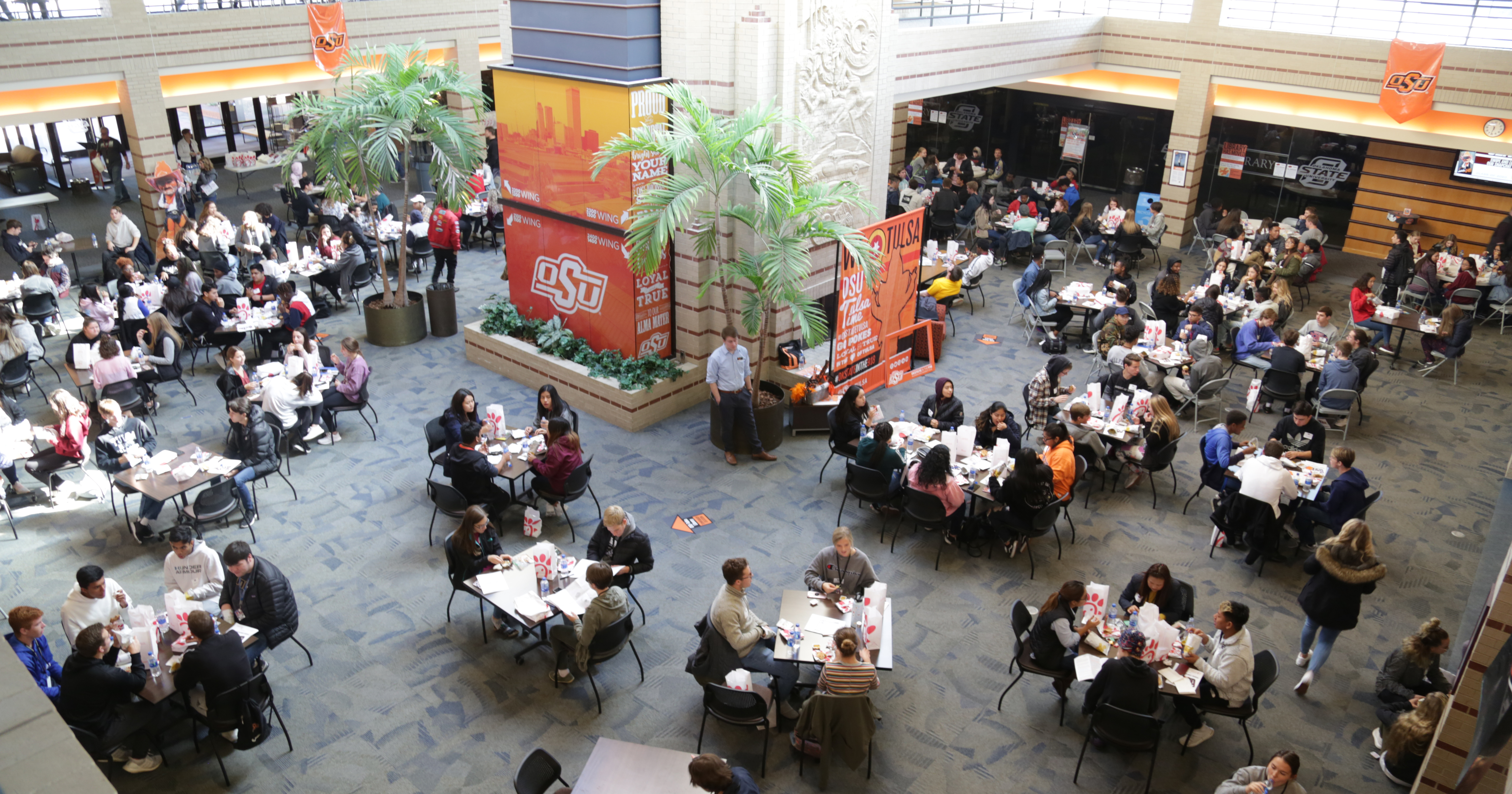 Jenks students fill Main Hall for lunch between conference sessions.