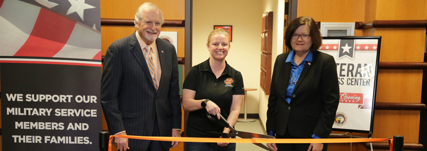 OSU-Tulsa President Howard Barnett, left, U.S. Army veteran and student Michelle Jackson and Provost Dr. Pamela Fry cut the ribbon during the grand opening of the OSU-Tulsa Veteran Success Center.