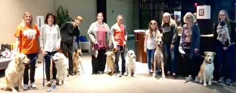 The newest members of P3T relax after completing the Canine Good Citizen tests recently in Founders Hall at OSU-CHS.