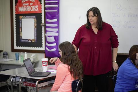Tulsa Public Schools English teacher Tamara Danley answers a student's question about writing research papers.