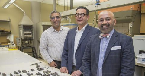 Dr. Raman Singh (right) stands by equipment and materials in one of the HRC labs.