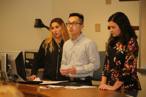 OSU-Tulsa students Angela Moore, left, Andrew Vang and Bailey Mathes present their design for an after-school exercise program for children at John 3:16 Mission.
