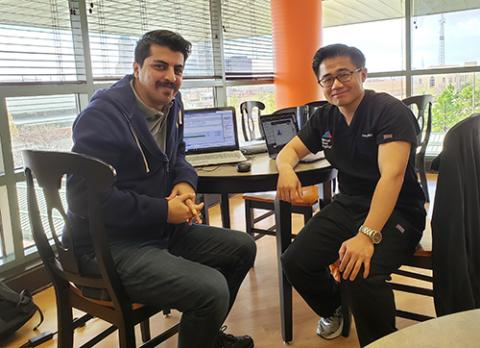 "Former OSU Ph.D. student Dr. Behrooz Davazdahemami (left) worked with researcher and ER physician Dr. Paul Peng on using data to better understand the problem of ""bounce back"" among hospital ER patients."