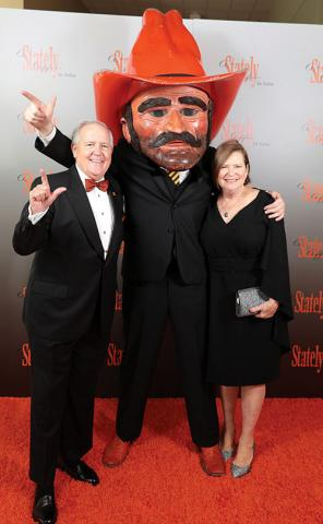 Jay and Fayenelle Helm, chairs for the 2019 A Stately Affair in Tulsa, celebrate with Pistol Pete during the gala.