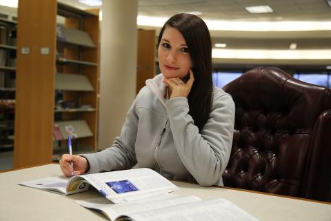 OSU-Tulsa graduate student Jessica Walter studies in the library.