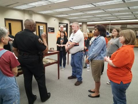 OSU-Tulsa Police Chief Melvin Murdock discusses the active shooter drill with library staff.