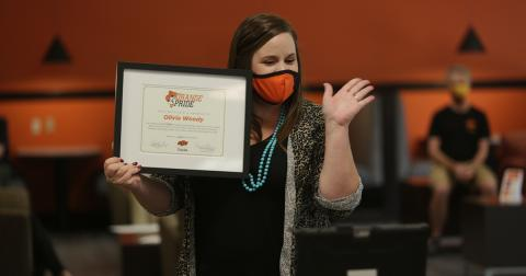 Olivia Woody accepted her Orange Pride Award during the 2020 Welcome Back event in the new Student Union.