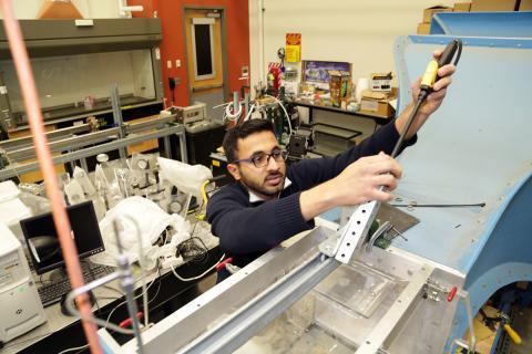 OSU-Tulsa student Saqib Raza in the lab