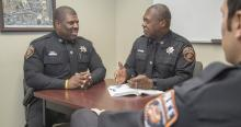 OSU-Tulsa Police Captain Michael Galbraith (left) in his office with Chief Leon Jones
