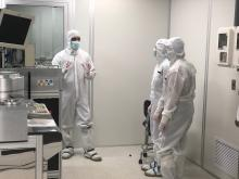 Zoe Ziftar and Elise Niehaus, right, learn about the Helmerich Research Center's clean room.