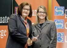 OSU-Tulsa Provost Pamela Fry presents Tara Urich the OSU Excellence in Teaching Award for Adjunct Faculty