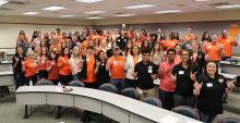 According to OSU graduate Cory Sales, involvement in the OSU-Tulsa President's Leadership Society, here with new campus President Pamela Fry in the first row, was important in his academic success. Sales, in the middle of the back row, graduated from OSU-Tulsa with a bachelor's degree in management information systems.
